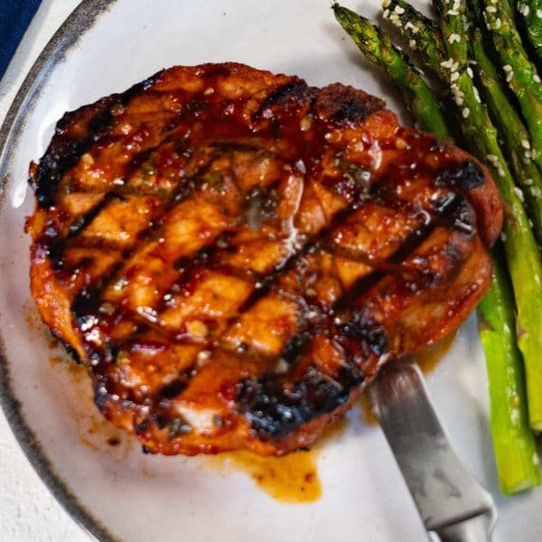 gochujang glazed pork porterhouse with sesame asparagus